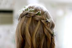 Flowers braided into hair