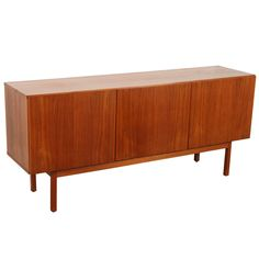 Mid-Century Danish Modern Teak Credenza Clean Lines   From a unique collection of antique and modern credenzas at https://www.1stdibs.com/furniture/storage-case-pieces/credenzas/