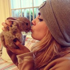 Baby Bunny from Cutest Celebs With Animals Pics  Cara Delevingne gives a sweet kiss to a baby bunny.