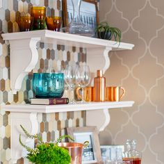 Satisfy storage and style with our kitchen shelves ideas. These built-in shelves have the elegance of fine furniture with open storage and a rod for hanging pots and pans.
