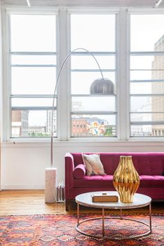 "Sneak Peek: An Eclectic Philadelphia Loft. ""The pink sofa and gold vase are both from Jonathan Adler. The marble table from Design Within Reach."" #sneakpeek"