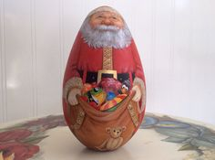 Toys on front and fireplace with stockings on back WoodenEggArt, $110.00