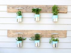 Blogger Summer from Simple Stylings took old paint cans and used spray paint, rope, and a couple pallet boards to create a hanging herb garden.
