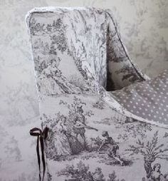 Sarah Hardaker - Pompadour Toile Fabric Collection - An armchair in off-white fabric featuring large, shaded grey scenes including people, with a black ribbon tie and a grey polka dot cushion Vibrant Colors, Colours, Black Ribbon, White Fabrics, Vintage Patterns, Pompadour, Vintage Inspired, Roman, Wallpaper