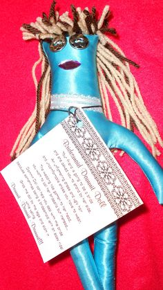 Bridesmaid Dammit Doll is wearing her uncomfortable blue satin dress-  by tobeesgifts, $16.95