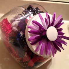 diy storage for hair bows etc. - here I added a gerber under the handle and screwed it back on... Again (see my other DIY pins on this canister idea) these r just canisters we bought at the store and sprayed the lids to match kids bathroom. Great storage for hair bows and bands. :)