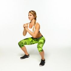 Stand with feet wider than shoulder-width apart and toes slightly turned out. Clasp hands in front of chest.    Explosively push off feet, bringing them together as you jump into the air, arms extended at an angle behind you. Land back in the squat position. That's one rep.