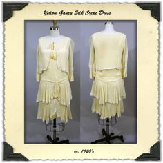 1920's day dress in a pale, butter cream yellow, gauzy silk crepe. It is fashioned with a fabulous little attached cropped jacket trimmed in lace. There is a self fabric bow at the center front neckline with two sweet little golden yellow silk crepe roses at the ends. The sleeves finish around elbow length with belled cuffs.