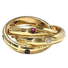 Cartier Trinity Ruby Sapphire Diamond Gold Ring | From a unique collection of vintage fashion rings at https://www.1stdibs.com/jewelry/rings/fashion-rings/