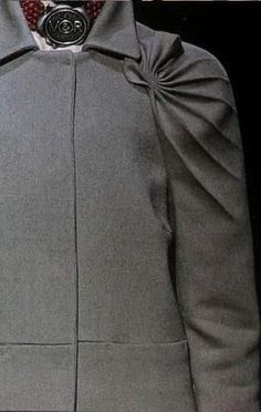 Grey coat with radial pleats; fabric manipulation; sewing inspiration; close up fashion detail // Viktor & Rolf Fall 2007