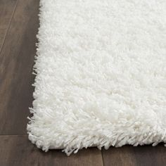 Safavieh Cozy Solid White Shag Rug | Overstock.com Shopping - Great Deals on Safavieh 7x9 - 10x14 Rugs