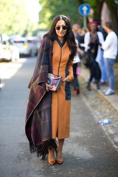 I am so glad that shawls, capes and ponchos are big again this season. This combination of shawl and dress is yummy, like a warm creme brulee!  Nausheen Shah   - HarpersBAZAAR.com