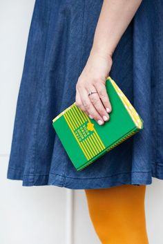 Rescue an old book from the trash + resuscitate it into a cute, kitschy clutch with this sewing DIY.