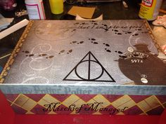 """Harry potter """"treasure"""" box made with mod podge and scrapbook paper and vinyl words cut out with silhouette cameo."""
