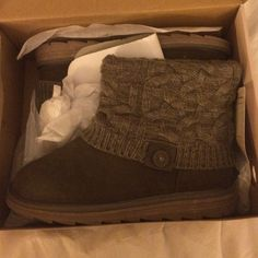 Brand new knitted fold over boot Never worn - tags still attached. Size 9. The color is a like a grayish brownish kind of color. Shoes Ankle Boots & Booties