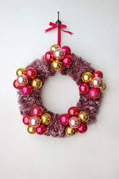cute wreath with tinsel garland and ornaments