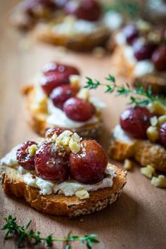 Roasted grape crostini with goat cheese and walnuts.