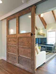 Contemporary Hallway with Custom modern barn door, Barn door, Hardwood floors, Crown molding