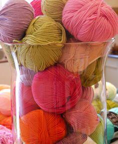 Pretty yarn storage in glass vase