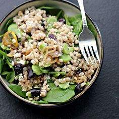 Warm Fava bean and barley salad with spinach, kalamata olives, shallots, and feta