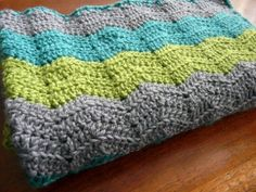 Super soft, warm baby blanket in gray, lime green and dark turquoise via Etsy
