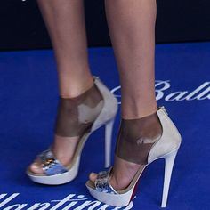 Taylor Swift Wears Transparent Christian Louboutin 'Dufoura' SandalsTaylor Swift in snake-print and transparent PVC platform sandals from Christian Louboutin's Spring 2013 collection
