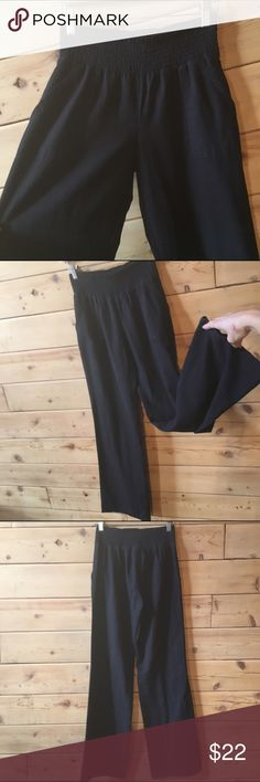 Comfy linen blend Wide elastic waist band is comfortable and flattering. Fabric grain looks like linen but poly blend feels more soft and durable. Med weight, not stiff. Front pockets. Suitable for street or beach, even maternity. Joe B Pants