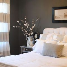 Love the tufted headboard,  striped curtains and dark wall ~ which is Benjamin Moore Kendall Charcoal
