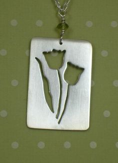 Pierced and sawed sterling silver tulips pendant - Art Jewelry Magazine - Jewelry Projects and Videos on Metalsmithing, Wirework, Metal Clay...