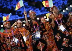 Members of Cameroon's contingent take part in the athletes parade during the opening ceremony of the London 2012 Olympic Games at the Olympic Stadium July 27, 2012. REUTERS/Kai Pfaffenbach