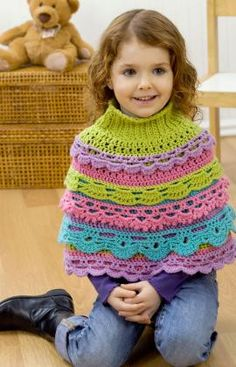 Girl's Ruffle Capelet - It looks so tight on this poor girl, I think I would have to do a few increases to the pattern!
