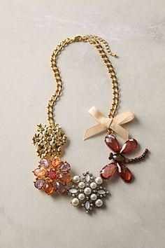 anthropologie necklace -- not a 'knock off' yet, but it would be easy to use 4 vintage pins.