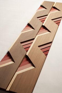 These geometric wood surfaces can be used on the interior or exterior to cover any kind of surface you would panel or tile.