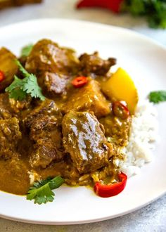 This Coconut Beef Curry Stew is a delicious, creamy sauced beef curry without all the waiting and ingredients typically in a curry. Perfect mid-week dinner. keviniscooking.com