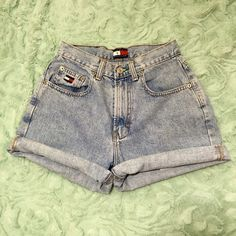 Vintage Tommy Hilfiger high waisted shorts Excellent condition. Vintage Tommy Hilfiger. High waisted Jean shorts. Waist measures 24inches and hips measure 29 inches. Light wash. Tommy Hilfiger Shorts Jean Shorts
