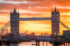 Dramatic Sunrise, Tower Bridge, River Thames, London, England. The bridge (built in 1894) is a combined bascule and suspension bridge. The bridge is 800 feet long with the towers each 213 feet high. The span between the towers is 200 feet and can be raised to an angle of 86 degrees to allow boats to pass. Inside the bridge there's The Tower Bridge Exhibition, a major tourist attraction, with a glass floor across the high-level walkways connecting the two towers.  My images are registered…
