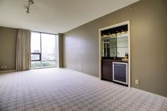 Living Room boasts high end designer carpet and draperies.  Shades provide extra UV protection.  Wet Bar in Living Room. Sprinklers.  Open a bottle of wine, relax and enjoy the sunset! Spectacular views of downtown.