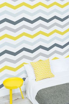 Looking for kid's bedroom ideas? Inject some fun and vibrancy into your home with this yellow and grey wallpaper design. The grey tones are contrasted with a mustard yellow and tied in with a chevron pattern. Making a super stylish and contemporary wallpaper choice.