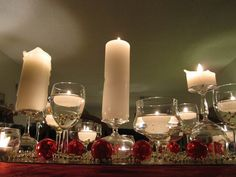 Christmas table centerpiece, Red Ornament, silver beads, wine glasses and candles