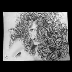 Sketch of a girl with curly hair. Sketched by me