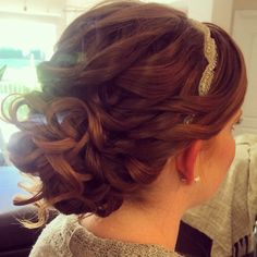 Loose looking, romantic bridal updo. Soft low bun Freelance bridal hairstylist servicing Charlotte, NC www.danaraiabridal.com