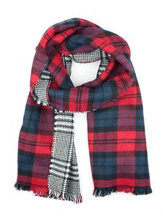 An on trend highland inspired design this winter. Our reversible scarf combines a traditional red & blue tartan with a black & white houndstooth print.