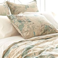 Cotton sateen sham with a feather motif.   Product: ShamConstruction Material: Cotton sateenColor: