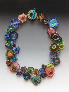 Pendant 30mm round with flower design lampworked glass multicolored