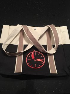 Tote bag with a clock and peppers inside the clock! Comes in black and beige... lightweight and easy to carry!  wildmoonsalsa.com to order!