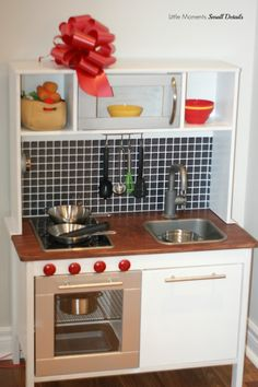 I want to paint the one Jack will have like this, except hack the cabinet under the sink so that the door opens sideways.   Ikea Play Kitchen HACK By Little Moments Small Details