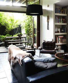 James Geer / Inside Out {black, white and wood eclectic vintage mid-century modern living room} by recent settlers, via Flickr
