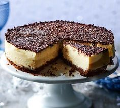 This decadent, make-ahead dessert is perfect for a festive dinner party or buffet, with a zesty cream cheese filling and dark chocolate biscuit base