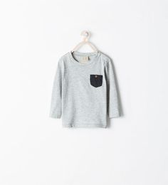 Image 1 of LONG SLEEVED T-SHIRT WITH POCKET from Zara