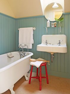 Extra-tall beadboard—painted in Benjamin Moore's Mill Springs Blue—covers the walls in this calming bathroom. Never thought to paint the beadboard in a non-neutral color. Bad Inspiration, Bathroom Inspiration, Bathroom Ideas, Bathroom Designs, Bathroom Images, Bathroom Colors, Bathroom Trends, Simple Bathroom, Lake Bathroom